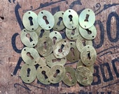 pair key hole escutcheon covers, 2 flat brass oval keyhole covers, assemblage jewelry supplies, small light brass hardware, vintage findings