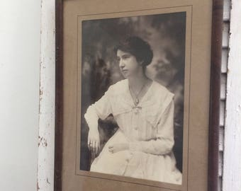 Vintage framed photo of woman in white dress, early 1900's photo