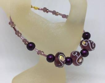 Bracelet Handmade Purple Glass Lampwork Bead with White Spirals by JulieDeeleyJewellery on Etsy