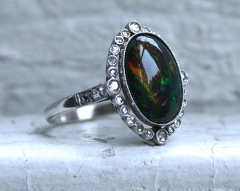 Gorgeous Vintage Black Opal and Diamond Halo Platinum Ring Engagement Ring.