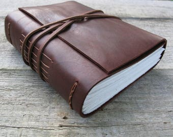 """Leather journal, """"You see things and you say why, but I see things that never were, and I say why not"""", Shaw quote / 320 pages"""