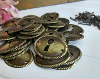 Lot of 42 New Old Stock Brass Keyhole Escutcheons With Rope Border
