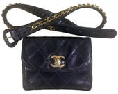 Vintage CHANEL black leather waist purse, fanny bag with golden chain belt and golden CC closure hock.