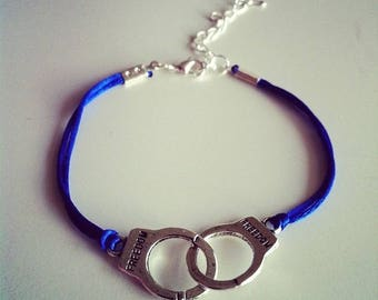 Blue cord with silver handcuffs bracelet