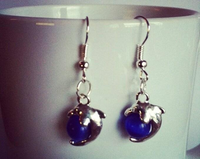 Dolphins Pearl dark blue glass earrings