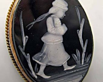 Victorian Black White Onyx Cameo Brooch, Winter Scene Girl Walking In Snow, Goldfilled Frame Bezel, Glossy Black Oval, White Painted Accents