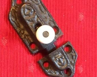 Black cast door latch