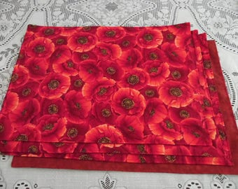 Poppies Set of 4 Reversible Placemats with Colorful Poppies On One Side With A Red Marble Fabric on Reverse Side
