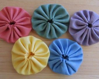 Yo yos 30 1 1/2  inch Peach, violet, pink, green, and blue solid Fabric YO YOS