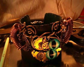 """Gift unisex,bracelet leather recycled,gear of pocket watch. Steampunk style . Series """"I Senzienti""""."""