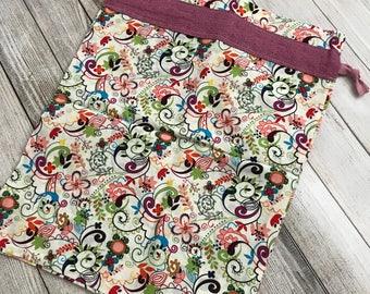 One (1) medium cloth travel bag