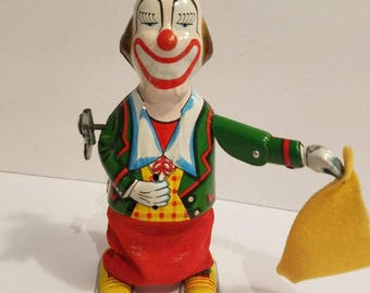 Vintage Wind Up Hopping Clown ca. 1950'