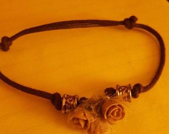 dark brown slip knot bracelet with 3 silk flowers