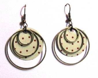 paper weight, bronze rings patterns sequins earrings
