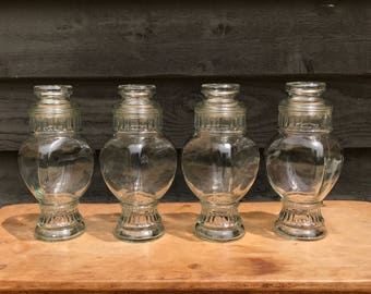 Four vintage glass apothecary jars