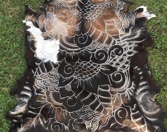 Handcarved goat hide