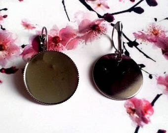 A pair of gun metal 25mm round cabochon earrings