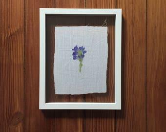 Violet flowers on linen