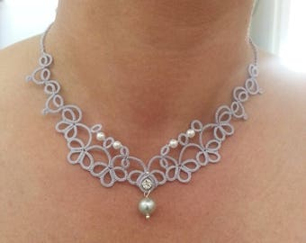 Delicate crew-neck lace tatting with beads