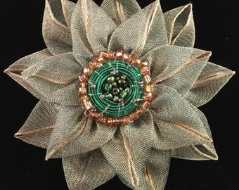 Festive green and gold flower brooch