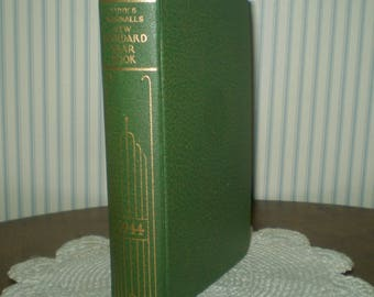 1944 Funk & Wagnalls New Standard Yearbook-1944- small size WWII edition of world events- green volume of 1944 history