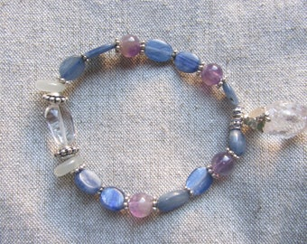 Blue Kyanite, Amethyst, Moonstone, and clear quartz pillow and clear quartz point, silver plated bead bracelet