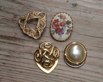 Four vintage scarf clips
