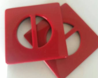 An acrylic buckle in shiny lipstick red with a black underside; 3 inches square. Bright and bold and I have 8 of them!