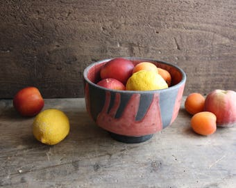 Black and red raku ceramic round bowl handmade