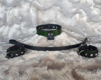 Black and green collar, cuffs, and leash