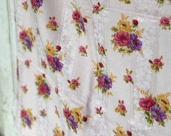 A beautiful vintage French sateen floral cafe curtain