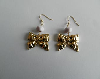Lampwork light pink stone bead and gold bow earrings