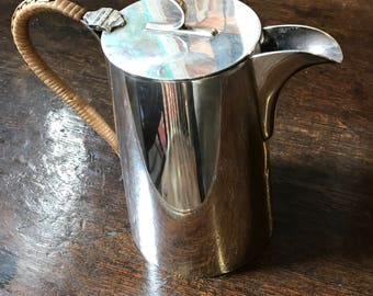 A walker and hall coffee pot in the style of Christoper dresser