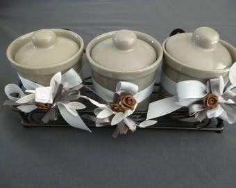 small trio display small grey earthenware jars, ribbons, pink: sweetness