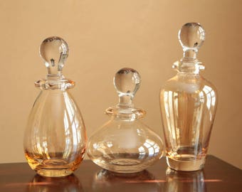 Vintage clear glass carafes / glass decanters with a lid / clear amber glass decor apothecary jars