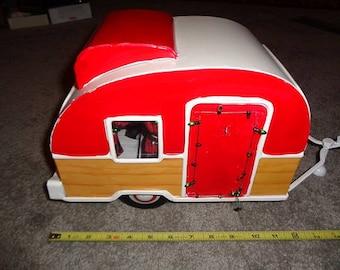 A large metal tear drop style camper,decor or display item