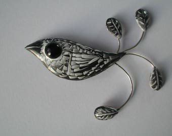 """""""Black and white plumage Tikwi"""" - sweater-enamels on copper brooch/charm"""