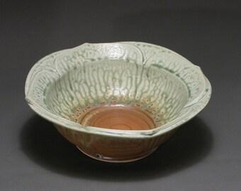 Serving bowl with lotus design, green ash and matt rust glazes