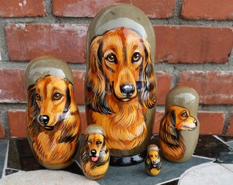 Dachshund on Five Russian Nesting Dolls.  Red.  Longhaired.  Dogs.