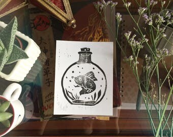 Fish in a bottle Lino print