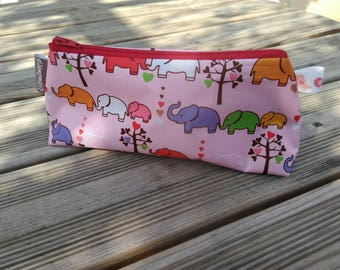 Waterproof fabric pouch with elephants in pinks and Red patterns