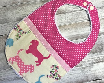 Bib for babies 12-30 months pink with dachshund dogs.