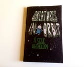 Creatures in Orbit -- an anthology of comics about animals who went to space.