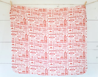 Swaddle blanket – Minnesota typography – red, white, words, up north, uff-da, MN, twin cities, baby, knit, soft, stretchy, modern, handmade