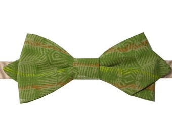 Bowtie green olive with sharp edges