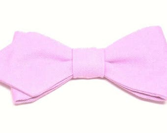 Purple bow sewn by hand with sharp edges