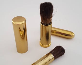 Vintage mid century pocket book make up brushes, gold tone brushes appear unused, one marked Japan, lipstick sizes