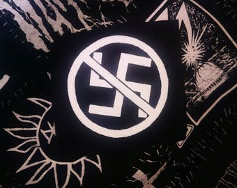 Hand painted anti swastika anti racism patch