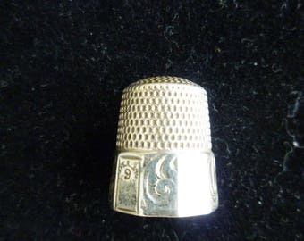 "Antique Sterling Silver Thimble. ""S"" inside, I believe that to be by Simons Brothers Co. Sterling Size 9. Four etched panels, four plain."