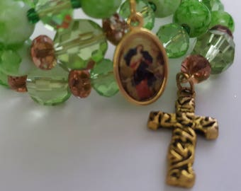 Green wrap around rosary bracelet featuring Mary undoer of knots and cross charm